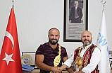 CW Enerji, başpehlivan Orhan Okulu'yu tebrik etti